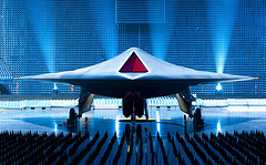 "The UK's Taranis stealth UAV. The Taranis exemplifies the move toward increased autonomy as it aims to strike distant targets ""even on other continents"", although humans are currently expected to remain in the loop. (Flickr/Qinetiq https://www.flickr.com/photos/qinetiq/4789729740/)"
