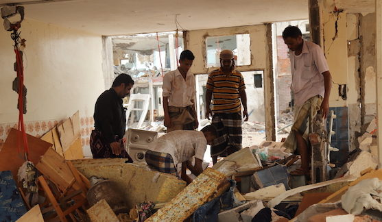 Men dig through rubble in a residential compound housing employees of the Mokha Steam Power Plant and their families following an airstrike by the Saudi-led coalition that killed at least 65 civilians in Mokha, Yemen on July 24, 2015. (© Ole Solvang/Human Rights Watch)