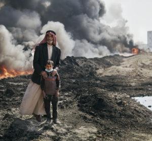Nadak Aziz and Kharim Ali, a village elder an a young boy pose for a portrait near the Qayyarah oil fires. October 25th, 2016. Joey L./Oxfam