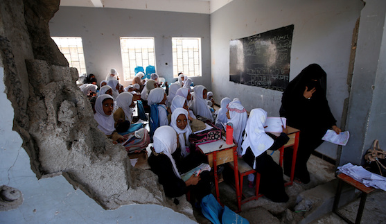 Girls attend a class at their school damaged by a recent Saudi-led air strike, in the Red Sea port city of Hodeidah, Yemen October 24, 2017. REUTERS/Abduljabbar Zeyad